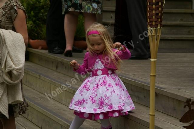 Small child dances in a pink and white dress