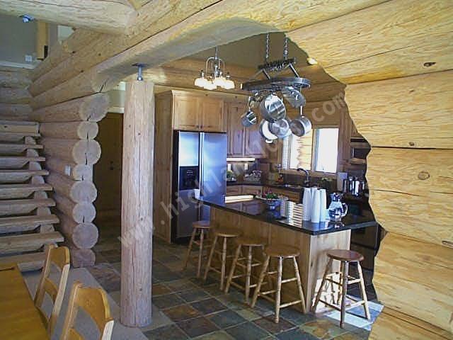 Log cabin interior photo gallerycontemporary log home for Log homes interior designs